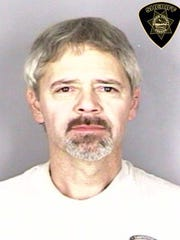 Kevin Acup, 51, of Salem, looked very different from his 2015 Marion County mugshot when officers arrested him on Jan. 17. He had dyed his hair blond and shaved his beard.