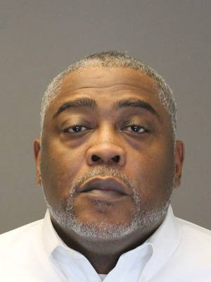 Ya'el Williams, 52, of Theills faces a felony charge for allegedly using counterfeit bills in Spring Valley. The executive director for Helping Hands, a Spring Valley-based nonprofit that helps the homeless, he was arrested Jan. 18, 2016.