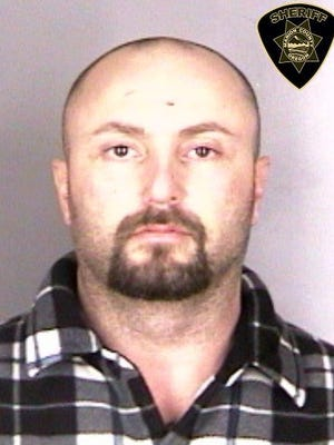 Daniel Lee Houston, 38, was arrested on charges of parole violation.