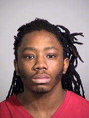 Larry Thomas, 20, was arrested by the Indianapolis