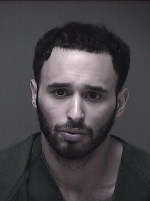 Brick police arrested Michael Santiago (pictured) along with Jamie Crippen and David Thompson on drug and gun charges Thursday. A photo of Thompson was not immediately available.