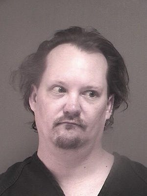David Redzikowski, 41, is facing multiple weapons and drug charges.