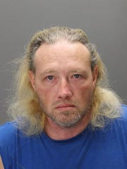 Adam Brown is charged as an accessory in a slaying while his brother Wesley Brown faces an open murder charge.