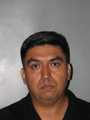 Roberto Escobar-Arcos was arrested by Dover Police on rape charges Monday.