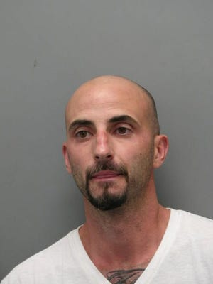 Jeremy Lobaccaro, 38, of Dover, was arrested Friday morning and is charged with committing two armed robberies earlier this week in Kent County.