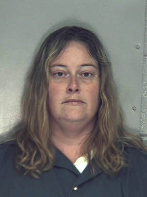 Shauna Stroup is one of two people accused of leaving four German shepherds to starve to death in a basement, resulting in three of them dying.