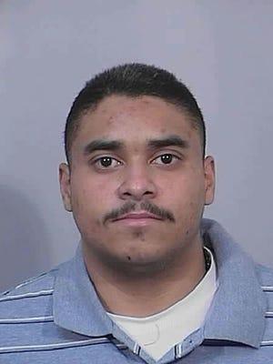 Photo of John Felix, suspected cop killer, taken while on parole in 2013.