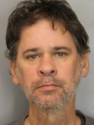 Michael Tielleman, 50, has been charged with robbing three New Castle County businesses, state police said.