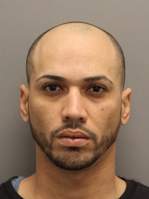 Jesus Serrano Torres, 30, of Ellendale, has been charged with drug and weapons offenses following a traffic stop.