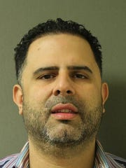 Angel Henriquez of Garnerville was arrested for allegedly running a benefits scam from his taxi company in Rockland County, the DA's office announced on March 8, 2017.