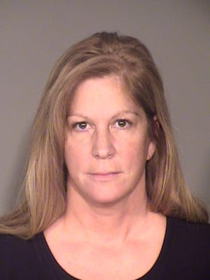 Kathleen Rene Mills, 51, of San Diego, was sentenced Monday to 24 months in county jail for embezzling money from several car dealerships in Oxnard.