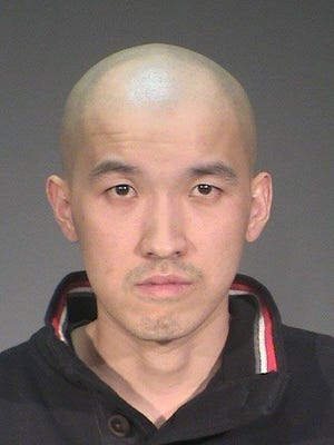 This undated photo provided by the Washington County Jail via the Star Tribune shows Dongzhou Jiang. Prosecutors in Minnesota charged four suspects, including Jiang, Wednesday, March 29, 2017, in an alleged sex-trafficking ring that targeted women who are Chinese nationals and kept them isolated.