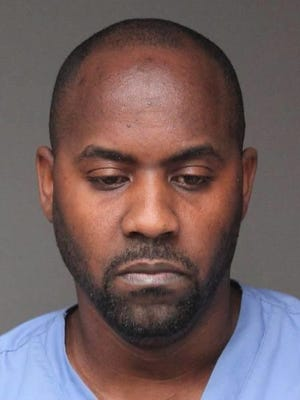 Layton McTavish, 38, was arrested on April 26, 2017, and accused of running a marijuana grow house from his Hartsdale home.