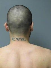Tattoo on escaped prisoner David Watson