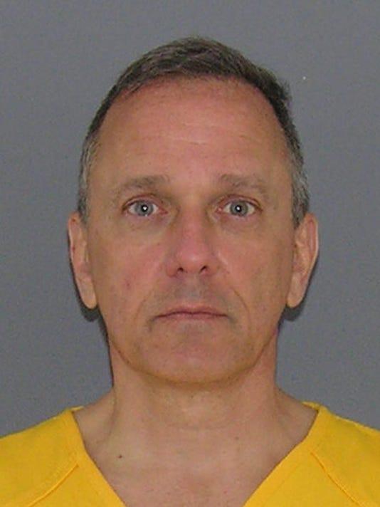636307962513552748-Jeffrey-Hawkins-jail-mug.png