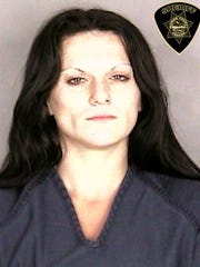 Angel Rogers, 32, of Salem, was arrested on assault and robbery charges Sunday.