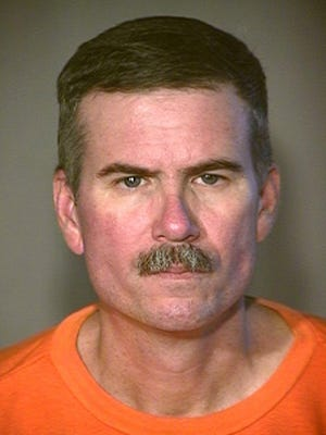 An undated booking photo shows Jack Hudson, a former undercover narcotics officer serving life terms for killing two fellow law enforcement officers in Yuma 22 years ago. The Arizona Department of Corrections says 59-year-old Hudson died Tuesday, Oct. 11, 2017, of natural causes.