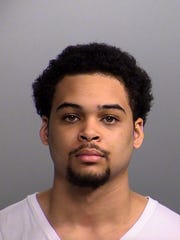 Devante Gilbert, 18, was arrested in connection with a July triple homicide.