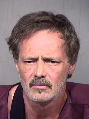 Michael Lynn Phillips, 55, was arrested Sunday on suspicion of fatally shooting a man in El Mirage.
