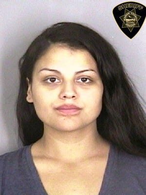 Vanessa Garcia-Baez, 24, was arrested on murder and robbery charges in connection to a fatal Salem shooting.