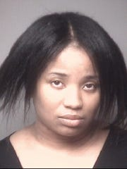 Tiesha Martin, 34, was charged with child endangerment after her children were found living in filthy conditions in her home.