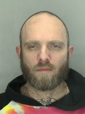Thomas Marsh, 40, was arrested and charged after police say he stole a vehicle from a Livonia Burger King.