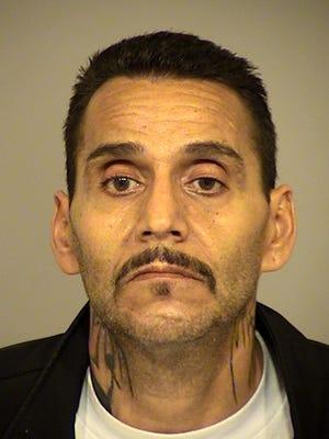 John Flores, 49, of Oxnard, was arrested Wednesday on suspicion of multiple firearm violations.
