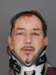 A booking photo of Robert Buck, taken shortly after his April 9, 2018 arrest.