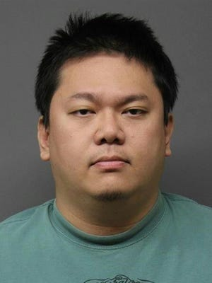 Yenhung Lee, 34, of Hackensack, was arrested for possession and distribution of at least 100 child pornography files.