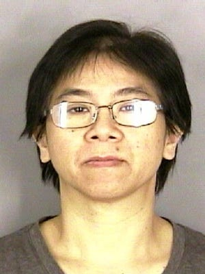 Chanh Tran, 47 of Woodburn, is being held on Attempted Robbery, Unlawful Use of a Weapon and Menacing charges.