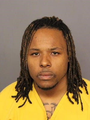 This booking photo released by the Denver Police Department shows Uber driver Michael Hancock, 29, who is accused of fatally shooting a passenger early Friday morning.