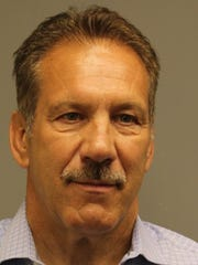Michael Capriglione, chief of police for the Newport Police Department, faces a felony count of evidence tampering after being accused of crashing his police vehicle into another vehicle in the department's parking lot, failing to report the damage and attempting to cover up the evidence.