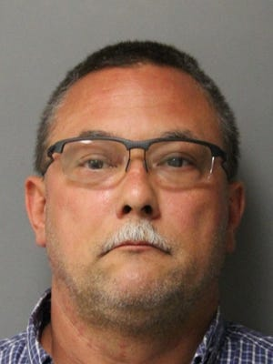 Corey C. Davis, 47, of Delmar, has been charged with receiving a bribe, a felony, misuse of computer system information, twocounts of prison contraband with intent to deliverand official misconduct with unauthorized exercise of official functions.