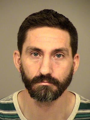 Colin Moore, 34, of Oxnard, was arrested after an investigation into a carjacking.