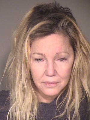 Heather Locklear's booking photo, taken following her arrest Sunday on two misdemeanor charges of battery against first responders.