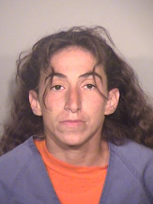 Alexandra Gindelsberger, 33, was arrested on suspicion of felony arson after a brush fire began just outside Simi Valley.