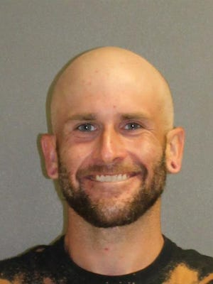 Zachary Kato, 32, is seen after his arrest by Daytona Beach Shores police on July 15, 2020.