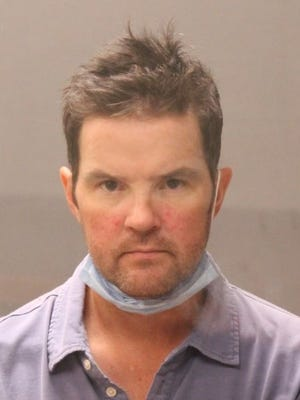 David McLean is shown in a Hingham Police booking photo.