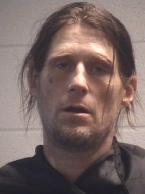 Michael John Forgach was arrested Wednesday and charged with trafficking heroin.