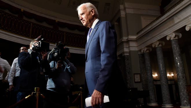 Vice President Joe Biden walks out of the Old Senate Chamber on Capitol Hill in Washington, Tuesday, Dec. 2, 2014, after performing two ceremonial swearing-ins for Sen. Tim Scott, R-S.C. and Sen. Brian Schatz, D-Hawaii. (AP Photo/Susan Walsh)