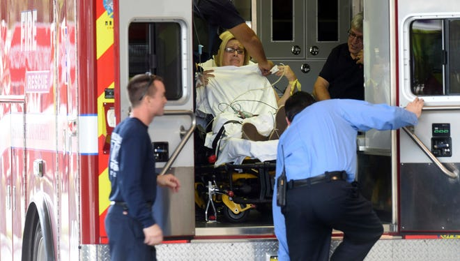 """A shooting victim arrives at Broward Health Trauma Center ON Friday, Jan. 6, 2017 in Fort Lauderdale, Fla.  Authorities say a lone shooter opened fire at the Ft. Lauderdale-Hollywood International Airport Friday, killing """"multiple"""" people before he was taken into custody. The airport suspended operations as law enforcement authorities rushed to the scene."""