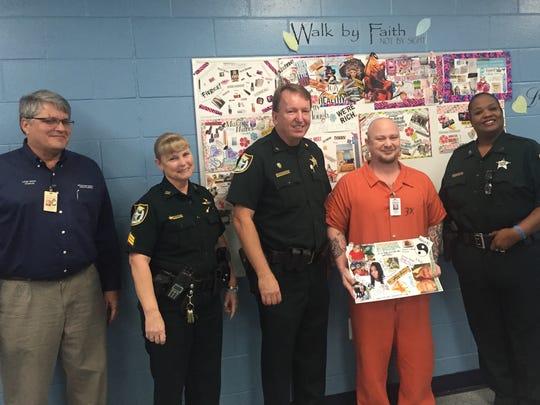 Chaplain Louie Tropf, Sgt. Candace Carter, Maj. Selby Strickland, Damon Laziman and Deputy Ella Goodman in the classroom.