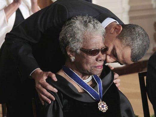 President Obama kisses author and poet Maya Angelou after awarding her the 2010 Medal of Freedom during a ceremony in the East Room of the White House on Feb. 15, 2011.