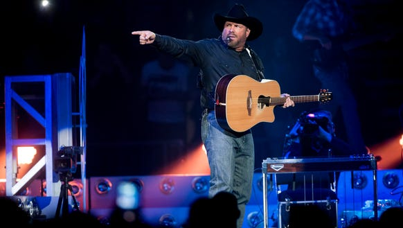 Garth Brooks performs during his opening show at the