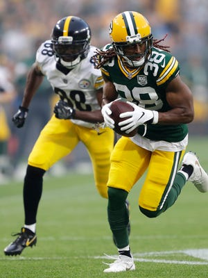 Green Bay Packers defensive back Tramon Williams (38) intercepts a pass and runs it back for a touhdown on a pass intended for Pittsburgh Steelers wide receiver Darrius Heyward-Bey (88) in the first quarter during their football game Thursday, August 16, 2018, at Lambeau Field in Green Bay, Wis.