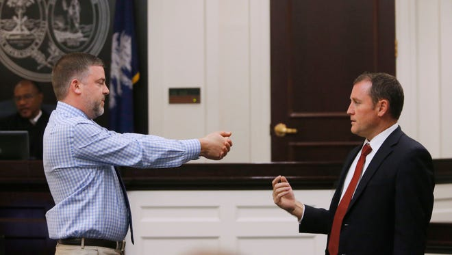 Levi Miles, left, a private investigator, gestures toward Assistant Solicitor Chad Simpson to demonstrate how Michael Slager said Walter Scott came at him with a taser. The demonstration  took place in the trial of former North Charleston Police officer Michael Slager at Charleston County, S.C., court on Nov. 14, 2016.