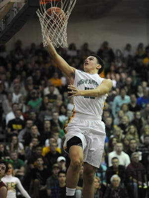 Floyd Central's Cobie Barnes makes a layup against New Albany at Floyd Central High School. He had 15 points. Dec. 11, 2015