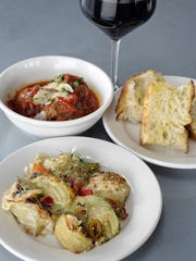 Gratinato di finocchio, bottom, has fennel, parmigiano reggiano, besciamella and olive pangrattato. Polpette, top left, has meat­balls, marinara sauce and ciabatta.