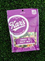 "Kar's new package of its flagship prodcut, Sweet 'N Salty Mix. The brand returns to its Detroit roots, including ""Detroit Born"" on all of its packaging."