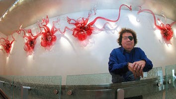Dale Chihuly posed with one of his works at the Spencer Theater.